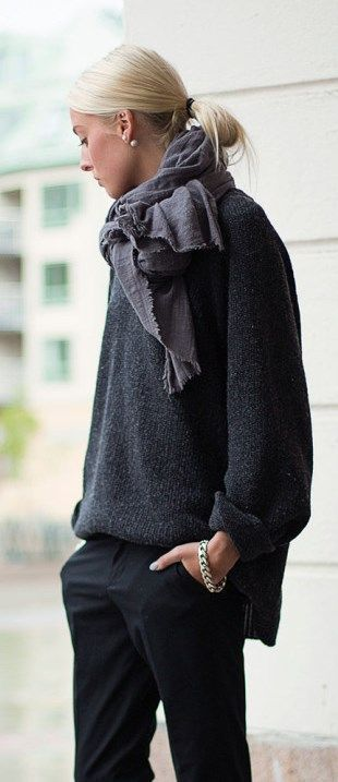 Low ponytail, gray sweater, chunky scarf, tailored black pants.
