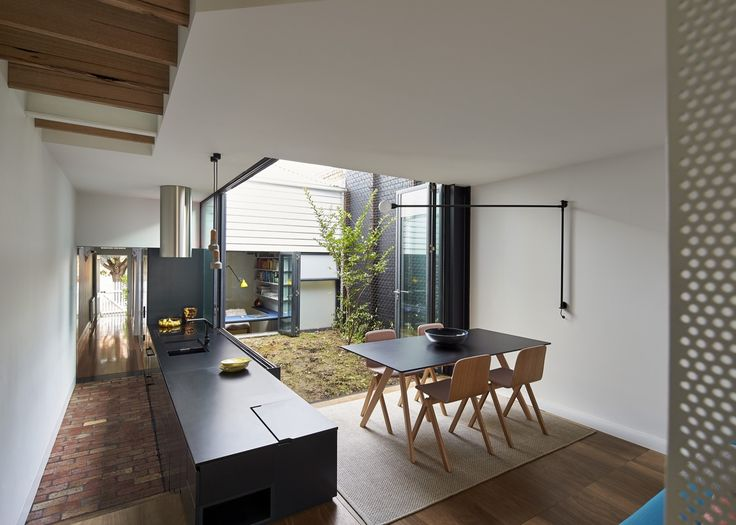 Large floor to ceiling windows offer visual link to outside and adjacent spaces. Linear corridor provides link.