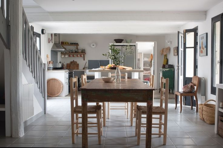 Modern farmhouse dining room and kitchen at The modern farmhouse kitchen at Mas Maroc, Amanda Pays and Corbin Bernsen's house in the South of France. Tim Beddow photo from Open House.