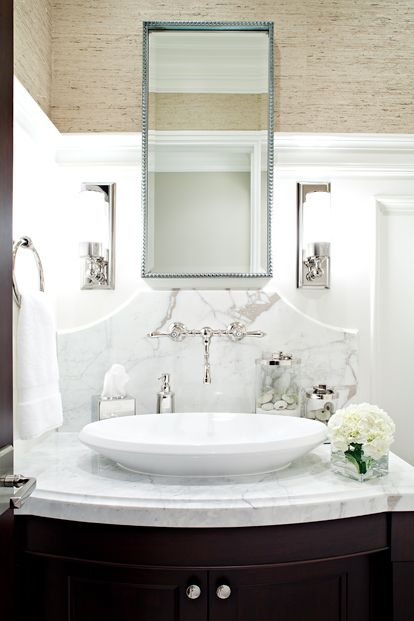 decorpad- Elizabeth Kimberly Design  Beautiful grasscloth walls and white paneled half wall. Espresso vanity with carrara marble counter and backsplash and oval vessel sink. Urban Archaeology Loft Light Sconces with beaded mirror.  OMG I LOVE EVERYTHING!!!!!
