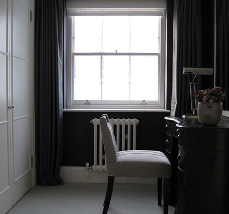 Haymarket Hotel designed by Kit Kemp  dark walls, white radiator