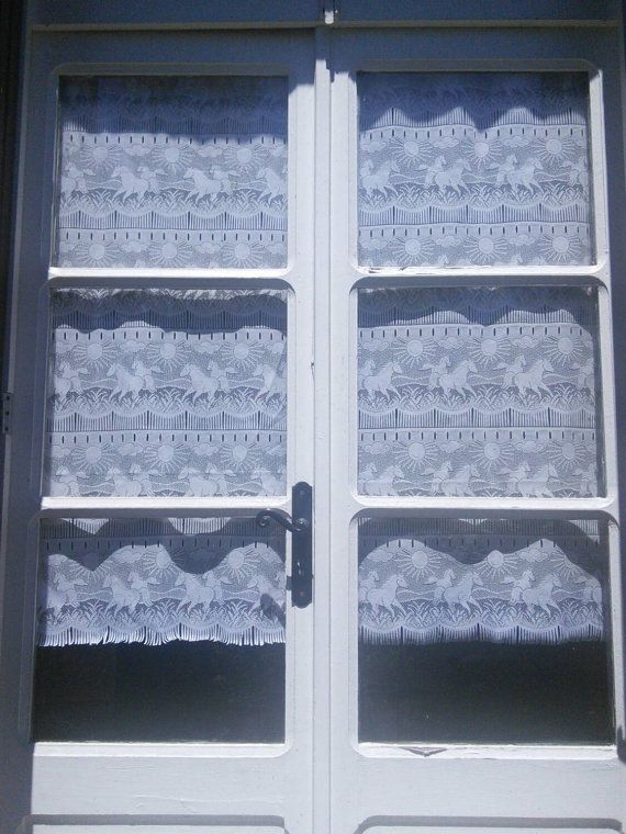 Check out this item in my Etsy shop https://www.etsy.com/listing/399076059/pair-lace-curtain-panels-horses-sun
