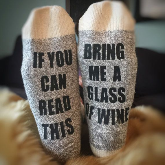 Wine Socks! If you can read this, bring me a glass of wine! Face it- we all have long days that leave us laying back with our feet kicked up. You want that wine, but ITS ALL THE WAY OVER THERE. Finally a solution. These socks serve as an announcement to any passer-bys. A flare signal for assistance. These socks will be perfect for moms, your wife, and women in general. They make perfect Christmas gifts for all of the ladies you know. Give her a gift she loves!  These socks are made of sock…