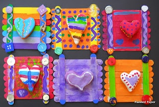 Craft for kids...Crazy Patterned Heart Collages. Made with model magic to create the hearts, craft sticks painted and glued together, buttons for embellishment added to the corners, and more patterns added to the background. Love it!