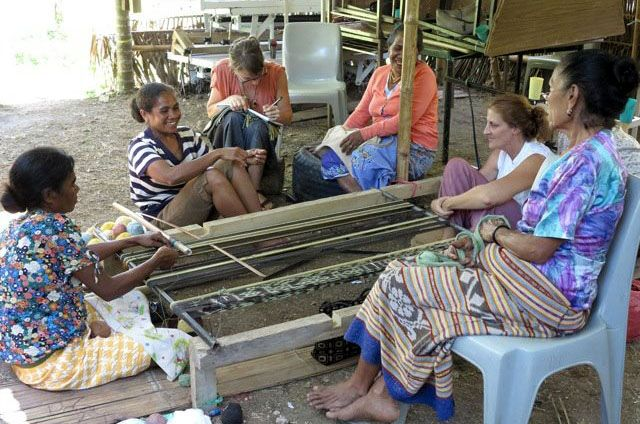 Weaving if a group activity. Members from the LO'UD Coopeerative & Volutneers from EWTA 2012