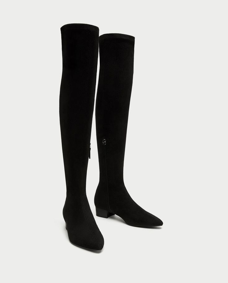 Over-the-knee boots are always outfit-transforming, bringing 70's glamour to every look.