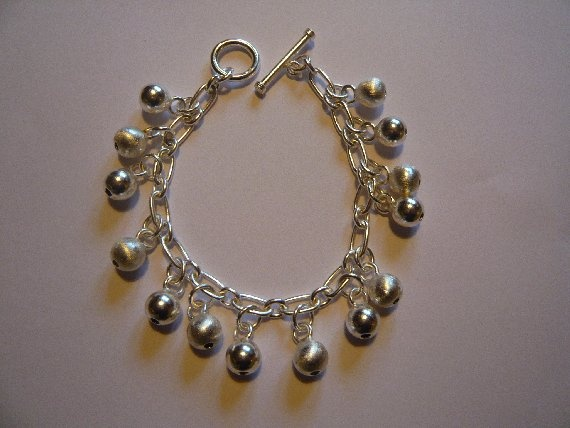 925 Silver Bracelet with Silver Baubles.