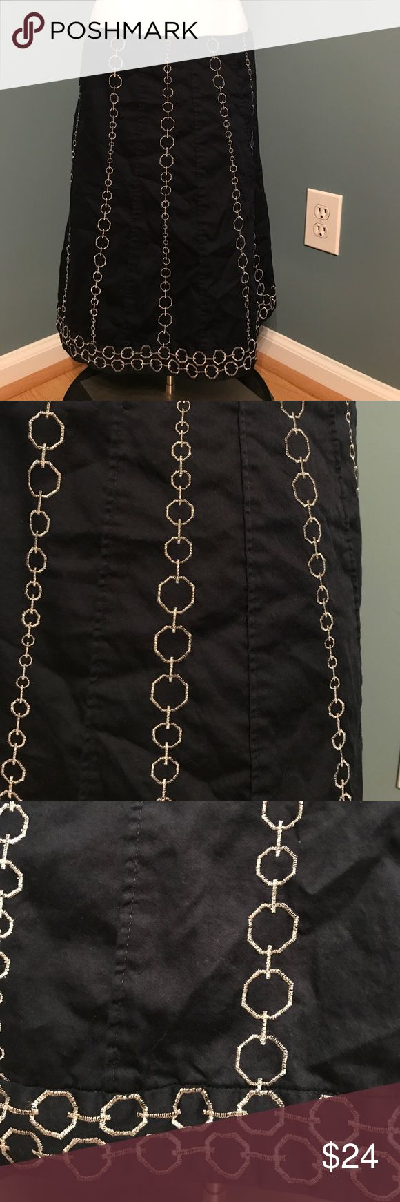 Ann Taylor navy blue skirt w/ embroidered silver Fully lined. Zipper closure with eyehook (one side of eye hook is missing) embroidered silver loops in a vertical pattern to create a slimming effect. Bottom is short has wrap around loops. Size 4 Ann Taylor Skirts A-Line or Full