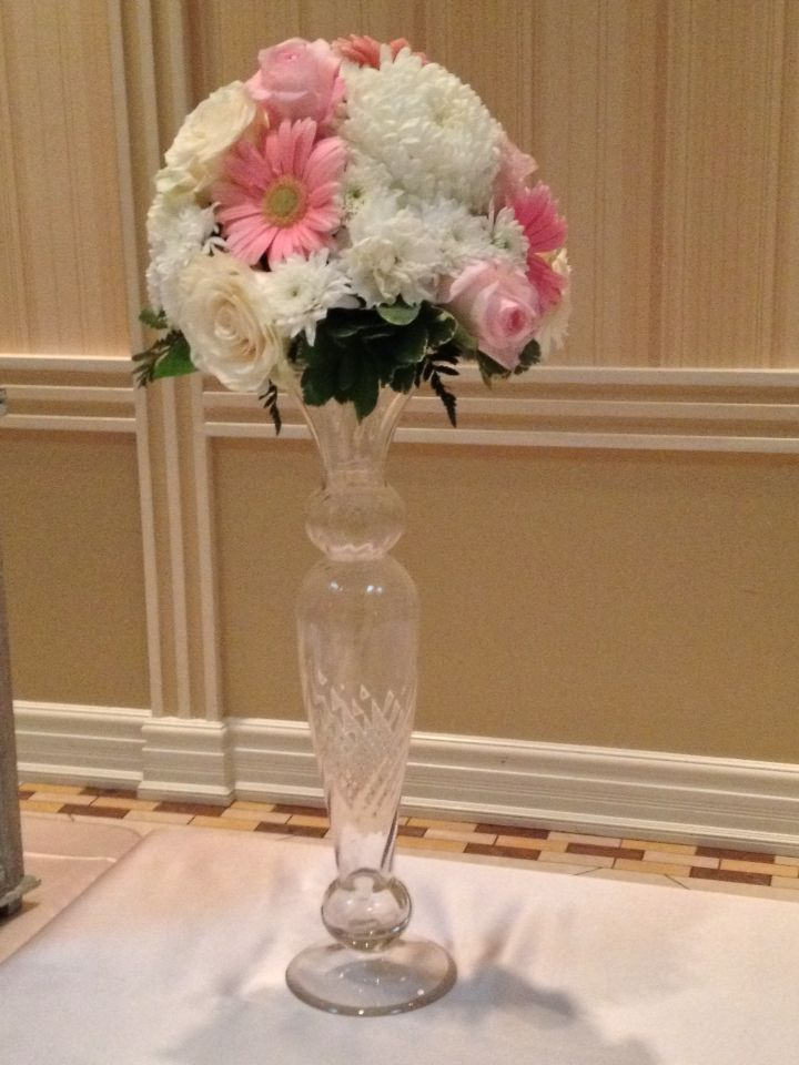 Pink gerberas as the focal flower for this guest book table arrangement.