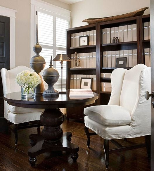 In any home with a formal dining room, consider using it as a home office/library instead.  Store your books on shelves along walls and treat it as a library and home office by day.  A table in the center can easily be set for guests when its time to entertain and serve a meal.