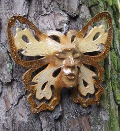 Butterfly Lady /Ceramic Art  Wall Mask Hanging. $85.00, via Etsy.