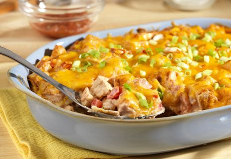 Kings Ranch Casserole..this king of all casseroles gets a punch of great flavor from picante sauce, chili powder and green onions. It's a flavorful way to use leftover chicken or turkey that will have your family coming back for more!