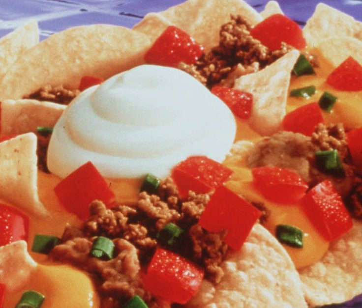 TIL During a 1978 Monday Night Football game to fill dead air Howard Cosell commented on a delicious new snack he was eating thus stadium nachos went mainstream.
