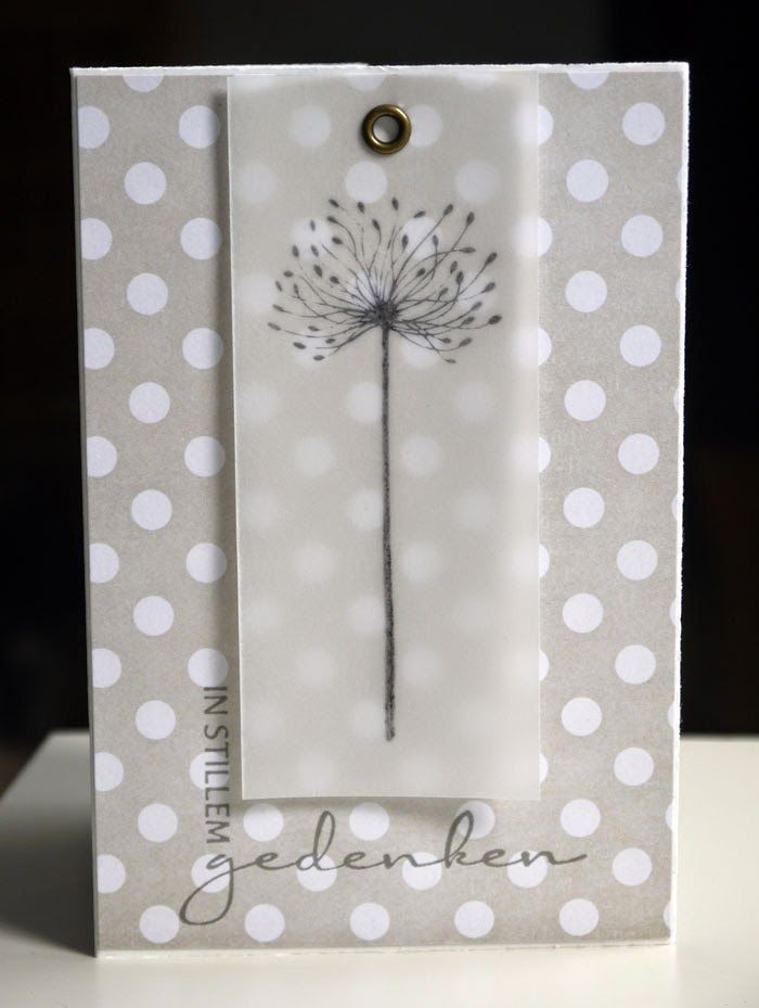 handmade card .. shades of gray .. luv the polka dot paper base ... column of vellum with stamped flower ... held onto card with only a gromme.