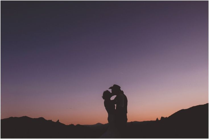 Cowboy groom and bride during country wedding in beautiful BC. Silhouette wedding idea \ Joelsview Photography