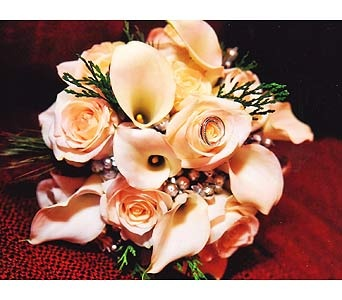A winter bouquet of roses, callas and silver tinted berries accented wtih cedar and pine.