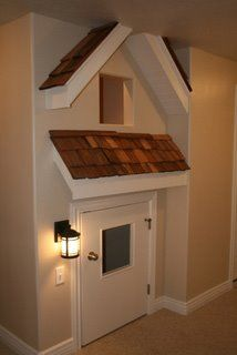 build in playhouse. So cute...especially if it lead into closet..attach the litte door and roofing/window to the closet door then when they grow up just replace door!!