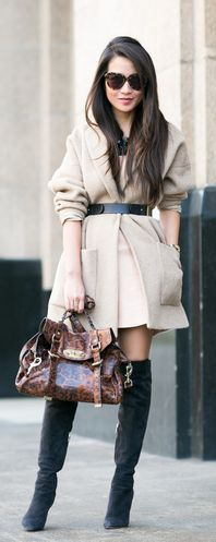 Coat With Belt Trend: Wendy Nguyen is wearing a beige cocoon coat from Armani Exchange and a belt