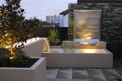 Modern outdoor fountain landscape. Want to do something like this in our front yard area.