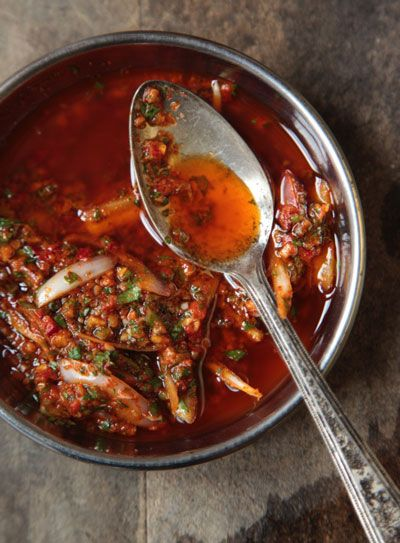 Charmoula Recipe - Saveur.com 3/4 cup extra-virgin olive oil 1 tbsp. fresh lemon juice 1 tbsp. fresh lime juice 1 tsp. ground coriander 1 tsp. ground cumin 1 tsp. sweet or smoked paprika 10 sprigs fresh cilantro, minced 4 cloves garlic, minced 1 red Fresno or Holland chile, stemmed, seeded, and minced 1 shallot, halved and thinly sliced Kosher salt, to tast