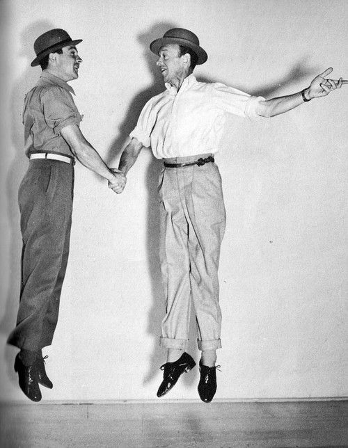 Gene Kelly and Fred Astaire shaking hands in midair, like anyone would expect.