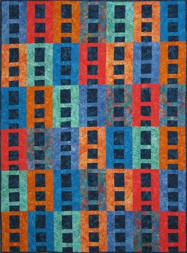 Designs to Share with You quilt pattern - Ready, Set, Go - designed by Ursula Riegel  A truly contemporary quilt.  Quick piecing methods and few seams to match make this an ideal quilt pattern for beginners. You will also learn to sew binding completely by machine.  Finished Size: 45.5