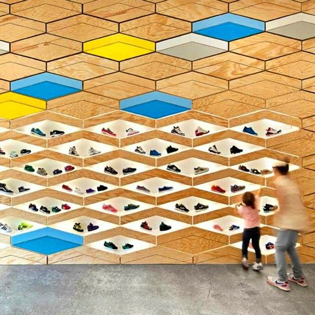 Home to kids footwear, the Suppakids Sneaker Boutique in Stuttgart, Germany was transformed when #architecture firm ROK created a pine display with diamond-shape niches. These unique structures made it possible to conceal or reveal the boutique's latest trends. #color #design #interiordesignmag #aprilissue #germany #footwear... - Interior Design Ideas, Interior Decor and Designs, Home Design Inspiration, Room Design Ideas, Interior Decorating, Furniture And Accessories