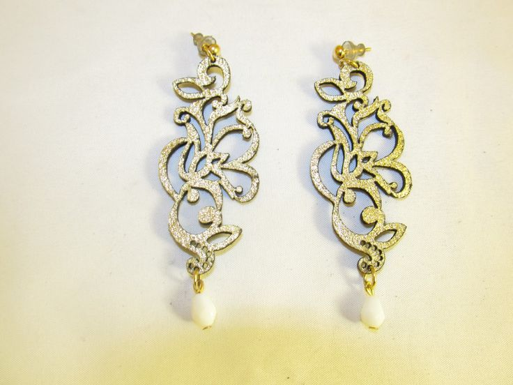 Handmade earrings with gold leather filigree (1 pair)  Made with gold leather filigree, antiallergic metals and white teardrop glass beads.