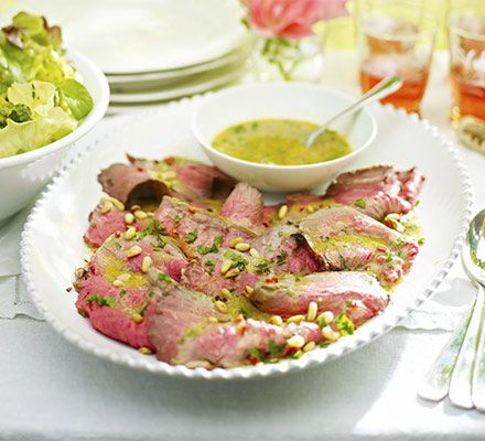 Roast a joint of sirloin until rare, serve sliced with a light vinaigrette and tell everyone to get stuck in