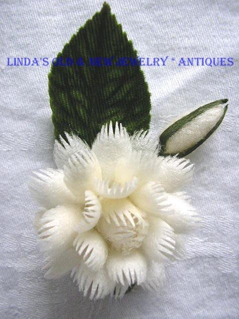Vintage Silk Cocoon Floral Handcrafted Pin. $16.50, via Etsy.