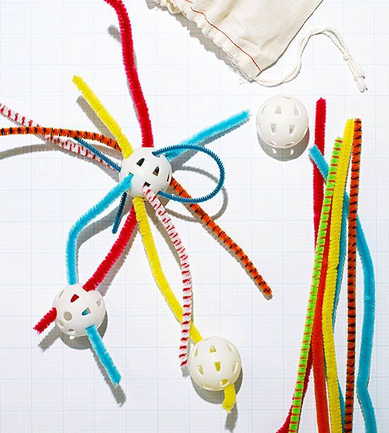 Pair chenille stems and plastic practice golf balls to make a compact lacing educational activity for toddlers.