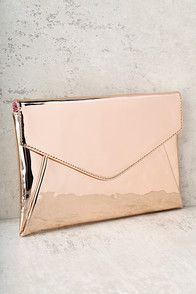 """You'll instantly be in love with the Take a Shine To Rose Gold Clutch! Shiny rose gold metal shapes this textured box clutch with a square clasp closure. Interior (with accordion sides) has just the right amount of room for all your essentials! Carry as a clutch or attach the 46"""" long gold chain strap."""