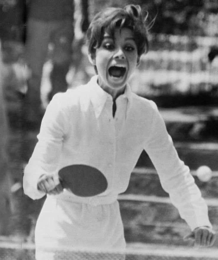 This beautiful lady on this image was Audrey Hepburn who was a serious table tennis player in the past.  With her reaction, I just wonder if she managed to hit the ball or missed it.