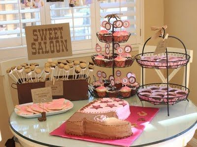 """desserts table for the groom... cake pops, cake, mini choc pies, and ? Minus all the """"saloon"""" stuff"""