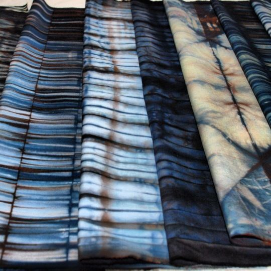 shibori. A Japanese term. For a range of techniques that involve manipulating the cloth and then binding or stitching it to create a resist befor bying