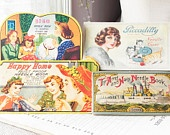 4 vintage sewing needle books
