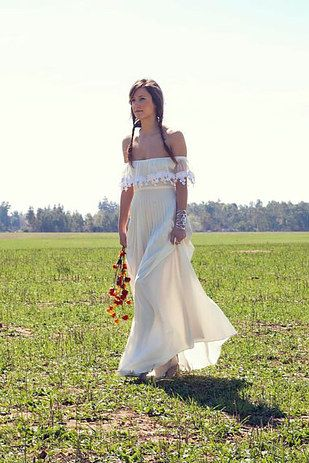 With a romantic crochet trim. | 36 Of The Most Effortlessly Beautiful Boho Wedding Dresses Ever