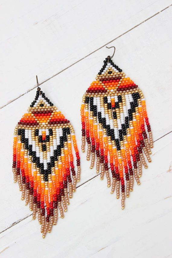 Size: The lenth of the earrings is approx. 3.9 inches (10 cm) The thread used is synthetic and very strong. Please ask if you have any questions.