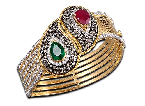 Mahesh Notandas, A magnificent bracelet set with white & brown diamonds, holding in their midst a gorgeous emerald & ruby, set in the beautiful antique look in 18kt. yellow gold.