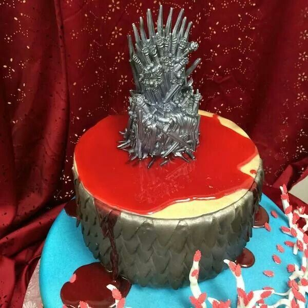 Cske gsme of thrones http://designtaxi.com/news/366105/A-Game-Of-Thrones-Inspired-Cake-Shows-The-Iron-Throne-In-A-Pool-Of-Blood/