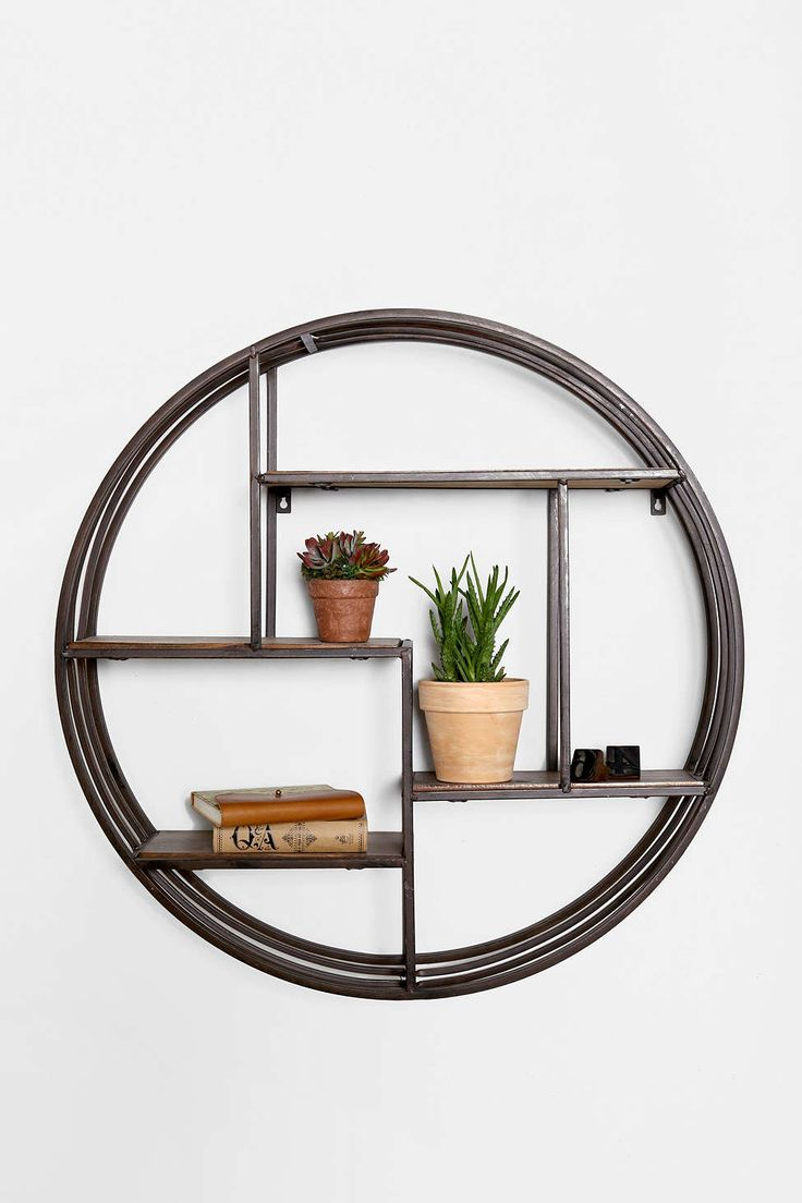 I'd put this in an Asian-inspired bathroom for some geometric interest. (4040 Locust Wooden Circle Wall Shelf at Urban Outfitters)