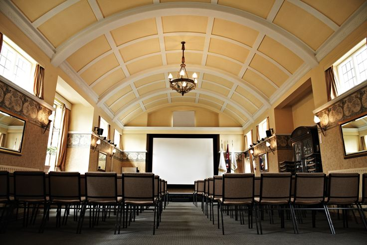 The large Training Room was originally the music room (hence the curved ceiling and the minstrel's gallery) and was added in 1938.