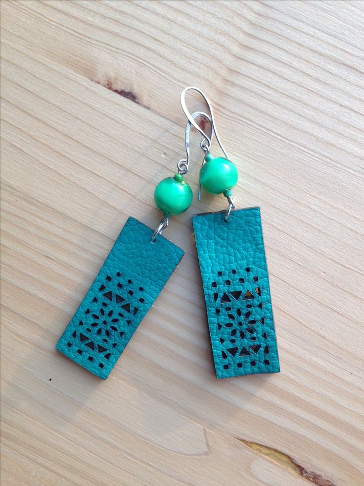 Lampwork earrings made with Murano glass beads and recycled leather.