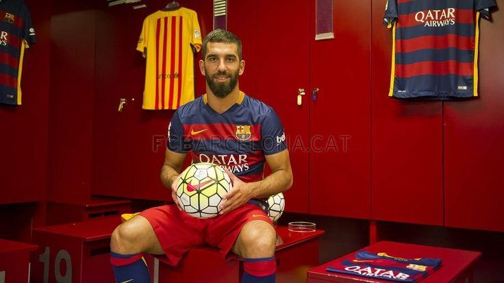 Arda Turan wearing the new Barça shirt | FC Barcelona