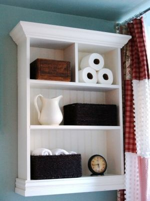 Over the Toilet storage..... You could totally buy a cheap shelf at Walmart and put the bead board in the back of each shelf and attach some molding to the top and bottom!