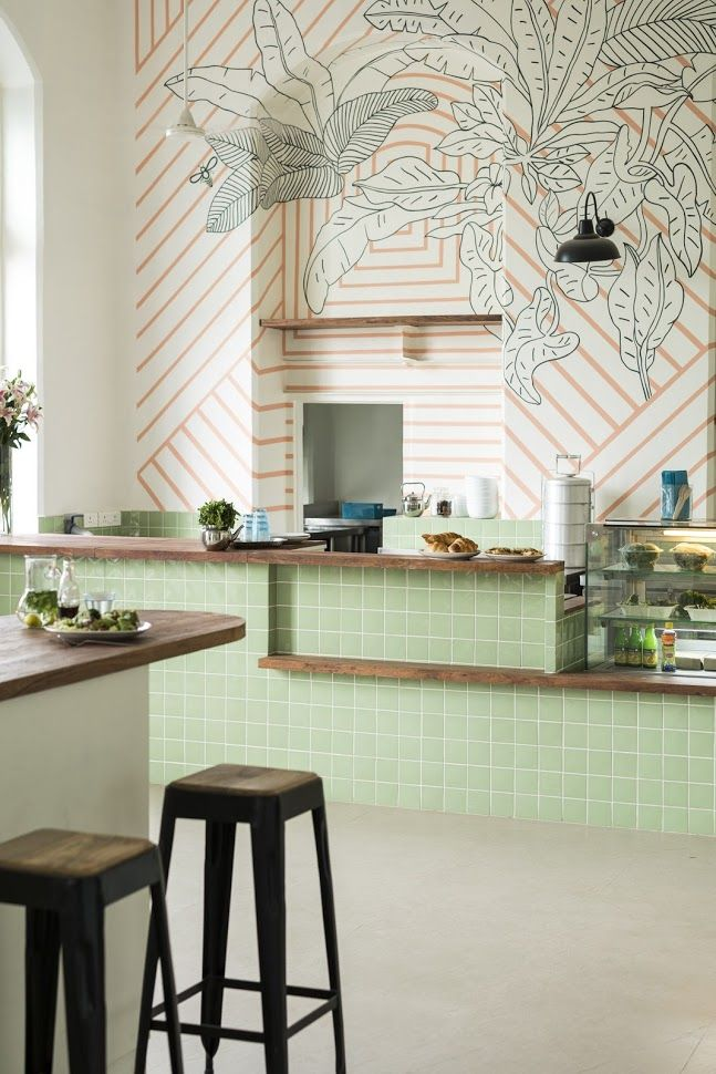 Mint and wood kitchen inspiration ministry of the new mumbai cafe mondays large scale mural with coral stripes overlaid with hand drawn monochrome