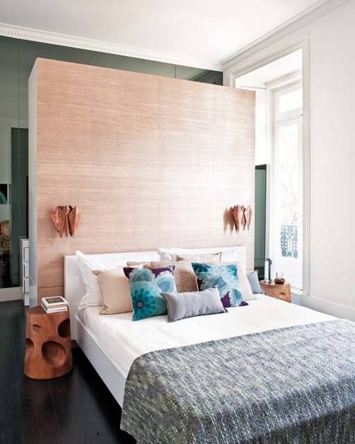 Grasscloth covering the backside of large pieces makes a textured surface headboard wall.