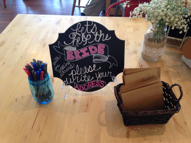 """All brides to be love the Thank you envelopes filled out.  """"Let's help the Bride with pre wedding stress Please write your address"""" #rusticwedding #rusticbridalshower #chalkboard #chalkboardsign"""