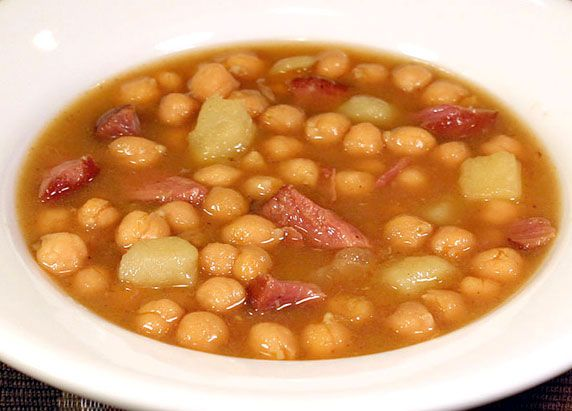A brothy Spanish and sometimes Cuban soup made with chickpeas (garbanzo beans), potatoes & ham hocks, seasoned with saffron. Fabulous flavor!
