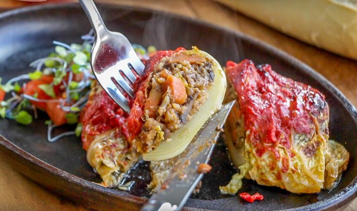These stuffed vegan cabbage rolls are made with tender leaves of cabbage wrapped around a hearty mixture of lentils, rice and vegetables, baked up until piping hot! This is definitely one of my favorite recipes.